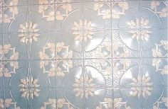 """Hand painted ceiling.  This is the Jasmine pressed tin design. The """"white"""" colour on the ceilings is really a very pale shade of the blue colour.  Looks like white but isn't white. If I had used white paint it would have looked way too harsh up against the blue background."""