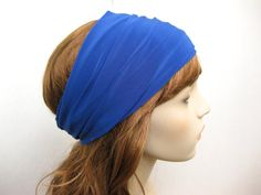 This intensely blue head wrap is made from from a light-weight polyester stretch knit fabric.    Measures approximately 6.5 / 16 cm wide