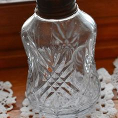 2018-02-01 My mom collects small oil lamps. This one has a beautiful cut #glass pattern in it that I like in the sunlight! #vintage #thrifting