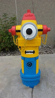Minion Fire Hydrant in Milaca, Mn. Painted by the O'Brien family.