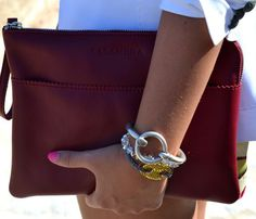 I repinned this first because of flat leather clutch...and now because of the bracelets! Love this!