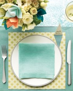 Turn a sheet of scrapbooking paper into a wonderfully whimsical place mat. Love the little cut out place card.