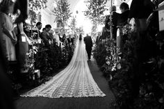 The bride and her father walking down the aisle. The church was decorated with jasmine and birch trees.