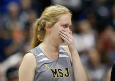 Lauren Hill, teenager with a brain tumor, fulfills dream.