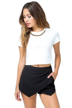 A trendy envelope skort featuring a layered front and a banded waist. Slanted hip pockets. Concealed zip and hook-eye closure in the back. Finished leg openings. Unlined. Looks amazing with a crop top and booties. $19.50