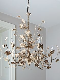 Our stunning Leaves Chandelier is the thing of fairytales. Made from intricately designed metal painted in an antique white colour with a distressed finish, this beautifully crafted large chandelier will add a touch to rustic elegance to your space.  Each chandelier includes space for six candle bulbs, all set upon hinged arms that are covered in an array of rustic leaves. With a simple chained flex and matching ceiling rose, this stunning oversized chandelier can be arranged to suit your…