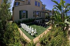 If you are gifted at landscaping — or can hire someone who is — try your hand at growing a giant chess board. Your guests will be delighted.