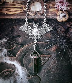 Bat Crystal Necklace Hawks Eye Crystal by WickedandLovelyStore