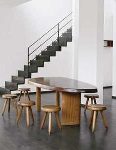 Charlotte Perriand, a free from makoré table with six matching stools, manufactured by André Chetaille, Steph Simon Edition, circa 1960.Christie´s