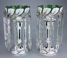 PAIR OF BOHEMIAN LUSTERS, WHITE AND GREEN OVERLAY CUT GLASS, HAND-PAINTED AND GOLD ACCENTED WHITE LEAVES TO THE EXTERIOR OR THE UPPER BOWL FORMING LEAF TO PETAL RIMS, WHITE GLASSCUTS VARIOUS SHAPES THROUGHOUT TO THE GREEN GLASS, NINE CRYSTAL SPEAR PRISMS   C.19TH CENTURY