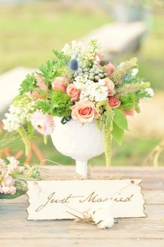 Gorgeous vintage white milk glass wedding centerpiece  Wedding bouquet with pink roses, blue thistle, and white larkspur Weddings » Open Rose Event Florals and Designs http://www.openroseevents.com/weddings/
