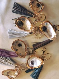Oyster shell key chain ring fob. Drill hole, paint gold trim & seal.  Attach to key chain