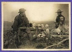 1903 photograph of S. Hall Young (at left) with another man looking at Yupik Eskimo skulls in western Alaska, circa 1903