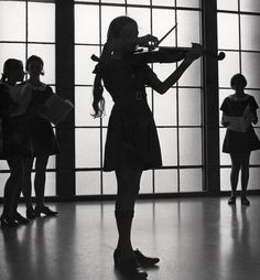 Violinist rehearsing at the Methodist Ladies' College in Burwood, Sydney    photo by Max Dupain, 1971
