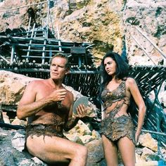 This image is from Planet of the Apes and features Charlton Heston as George Taylor and Linda Harrison as Nova Science Fiction, Linda Harrison, Image Film, Revolution, Cinema, Planet Of The Apes, Fantasy Movies, Thing 1, Tarzan