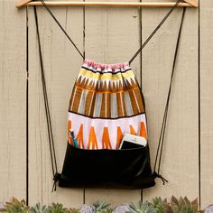 Aztec Drawstring Backpack with black front faux leather pockets - string bags - multicolor - limited