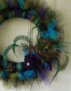 tulle peacock wreath...with just a little less glitter it would be perfect!