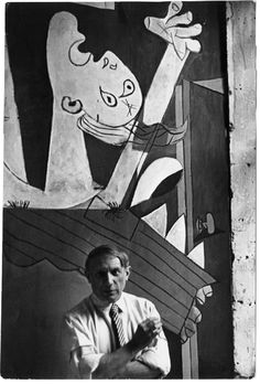 Pablo Picasso in front of his painting Guernica, 1937.    'We Went Back: Photographs From Europe 1933-1956 by Chim' is on show at the International Center of Photography, New York, until May 5 2013. In 1936, along with his friends Robert Capa and Gerda Taro, Chim traveled to Spain to photograph the civil war in support of the Republican side. See more at www.icp.org