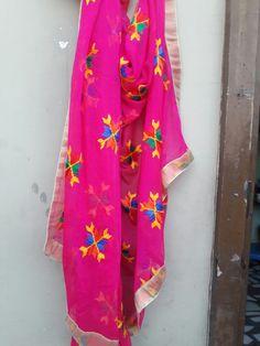 pair this fluroscently colored phulkari dupatta with black suit..