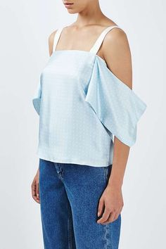 Look to a polka dot print to dress up your look this season with this luxe off-the-shoulder style by Boutique. A subtle pattern, it comes in a soft silhouette with boxy lines, and gently draped, oversized sleeves. #Topshop