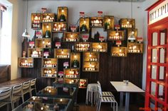 Mr. Bakery, Romania. Upcycled crates used as shelving for home made products, which are illuminated by bare bulbs. Love the telephone booth too!