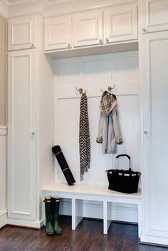 need one long cabinet for brooms and such on the end, so no one falls off the bench. @Ashley Walters Gilbreath - thinking something along these lines for part of the laundry room