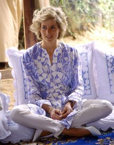 March 15, 1989: HRH Diana, Princess of Wales sitting cross-legged on cushions as he enjoying a Bedouin-style picnic lunch in a desert oasis near Al Ain during a visit to Abu Dhabi, United Arab Emirates.