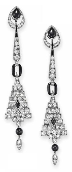 A PAIR OF ART DECO DIAMOND AND ONYX EAR PENDANTS, CIRCA 1925. Each suspending a circular and single-cut geometric plaque and tassel with onyx detail, from a circular and single-cut diamond line, to the onyx and single-cut diamond surmount, mounted in platinum and white gold. #ArtDeco #earrings