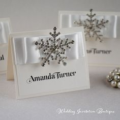 Snowflake Place Card in White from www.weddinginvitationboutique.co.uk