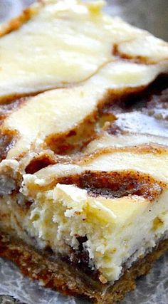 · These Cinnamon Roll Cheesecake Bars are such a dreamy, creamy masterpiece! Smooth, vanilla-scented cheesecake is swirled with a rich, gooey brown sugar & cinnamon swirl topped on a cinnamon graham crust. So easy, so delicious! Potluck Desserts, Just Desserts, Delicious Desserts, Dessert Recipes, Yummy Food, Bar Recipes, Recipies, Ramen Recipes, Fudge Recipes