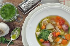 Soupe au Pistou, a classic French vegetable soup with a variety of fresh vegetables crowded in a rich chicken broth with a dollup of pesto.