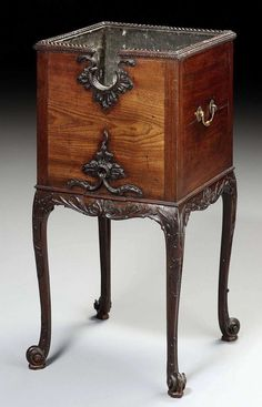 - A Carved Mahogany Kettle Stand In the Manner of Ince & Mayhew 17th,c.