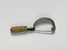 Bronze bow-shaped fibula (safety pin) with bone cylinder
