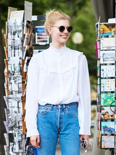 Style Notes: Boyfriend jeans will save your ruffled shirt from looking coquettish, so balance the two out. Featuring Ray-Ban round #sunglasses www.smartbuyglass...