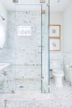 EJ Interiors - bathrooms - calacatta marble, crystal knobs, glass shower, lucite washstand, mirrored cabinet, polished washstand, subway tile, white bathroom, white marble, white trim, x cabinet,