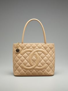 Chanel  i would love this to add to my clutter