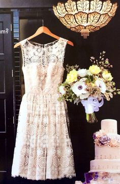 Gorgeous lace short wedding dress. Cut the cake dress. Reception gown