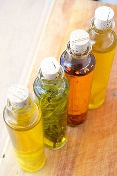 Infused lemon, chili, rosemary, and garlic oils DIY Garlic Infused Olive Oil, Flavored Olive Oil, Flavored Oils, Infused Oils, Cooking Tips, Cooking Recipes, Easy Recipes, Easy Diy Christmas Gifts, How To Make Diy