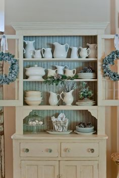 I am so painting my hutch a white washed color and leaving the inside stained. Nice!