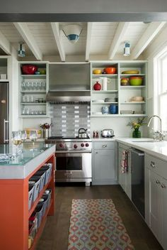 Easy-access baskets in a colorful kitchen island make snack storage easy.
