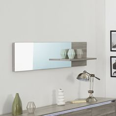 Long, narrow horizontal mirror has a foil finish block at one end that intersects a foil finish shelf for dramatic interest that blends with the Warren collection style. Set between the mirror and foil-finish wood grain section, the shelf is an extra storage space, and doubles the impact of whatever you display. Manufactured with Eco-friendly practices by Parisot Company, an accredited Green Way corporation.