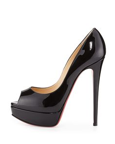 """Christian Louboutin patent leather pump. Peep toe sits atop 1 1/4"""" platform. 6"""" covered heel; 4 1/2"""" equiv. Low dipped vamp visually elongates legs. Leather lining and footbed. Signature red leather o"""