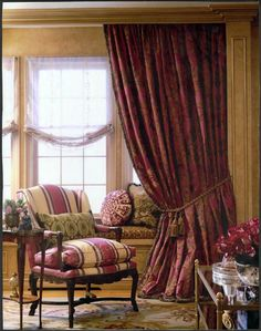 Fabulous bay window with seat, soft shades, lush curtains, beautiful chair and side table....very nice