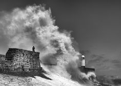 Sue Sayer posted a photo:  A windy afternoon at Porthcawl, South Wales, UK.  This man may not have realised but many stones were being thrown up as well as being a bit too close to the action.