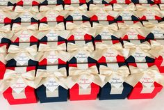 Navy Blue & Red wedding favor box with champagne satin ribbon bow and custom tag, Elegant Personalized gift boxes make a unique way to thank guests for attending your special day. #welcomebox #giftbox #personalizedgifts #weddingfavor #weddingbox #weddingfavorideas #bonbonniere #weddingparty #sweetlove #favorboxes #candybox #elegantwedding #partyfavor #giftboxes #uniqueweddingfavors #redwedding #bluewedding #champagnewedding Wedding Candy Table, Candy Wedding Favors, Wedding Gift Boxes, Wedding Favor Bags, Personalized Wedding Favors, Wedding Gifts, Wedding Favours Navy Blue, Blue Red Wedding, Elegant Wedding Favors