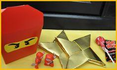 Ninjago favors: Takeout boxes with glued Ninjago eyes containing origami ninja stars using foil cardstock paper, ninja figurines, Pop Rocks and Tootsie Pops: