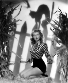 Wish I could look this lovely and glamorous while being frightened by a spooky black cat.