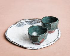 Plate and small cups. Raku inspired ceramics by Laura Allen Müller. Every item is unique and handcrafted in Copenhagen.