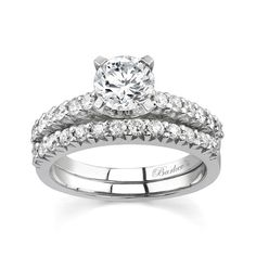 White Gold Bridal Set - 7199SW - Classic styling with a modern flair for the woman who values tradition, this diamond bridal set features a prong set round diamond center adorned with shared prong set diamonds cascading down the shoulders. The wedding band is adorned with diamonds to match the engagement ring and fits snuggly beside it for a glamorous affirmation of your love. Also available in yellow gold, 18k and Platinum.