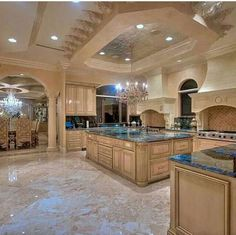 Great Kitchen Design and Ideas with Cabinets, Islands, Backsplashes – Photo Gallery – Luxury kitchen designs with very high ceiling with special beige decorations and spot lights. The kitchen has many ovens and a large wooden island in the middle of it. Luxury Kitchen Design, Dream Home Design, Luxury Kitchens, My Dream Home, Cool Kitchens, Home Interior Design, Kitchen Designs, Kitchen Ideas, Dream Kitchens